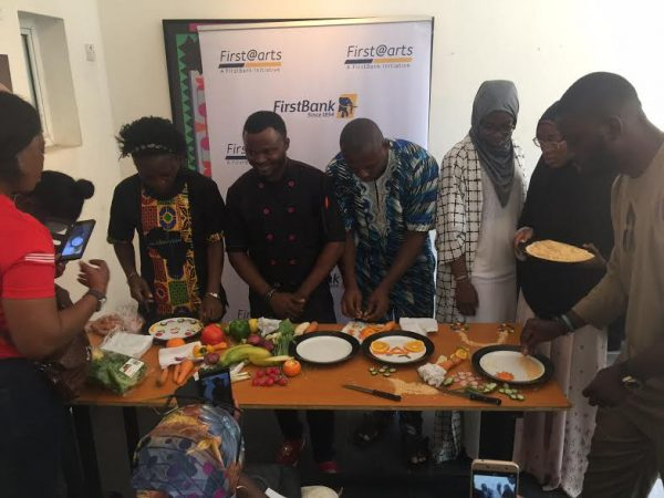 Haneefat teaches participants how to make food with art