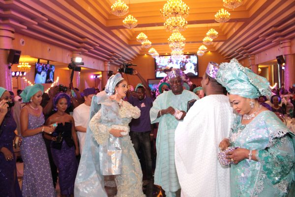 Bride and groom dance in presence of family