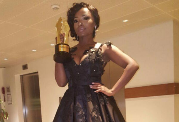 Meg Otanwa poses with her AMVCA trophy | TheCable.ng