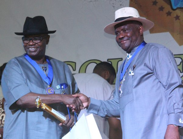 R-L Rivers State Governor, Nyesom Wike Presenting the Grand Service Star of Rivers State Award [GSSRS] to Godwin Abbe during the Rivers State Golden Jubilee Awards and houours Night Weekend in Port Harcourt. Photo: Nwankpa Chijioke