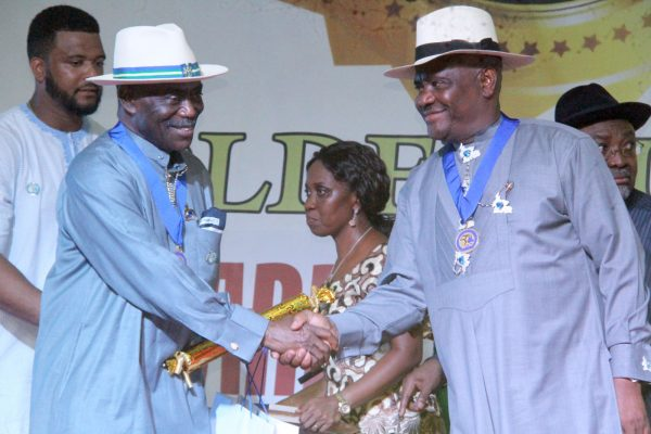 R-L Rivers State Governor, Nyesom Wike Presenting the Grand Service Star of Rivers State Award [GSSRS] to Dr Peter Odili, Former Governor of Rivers State during the Rivers State Golden Jubilee Awards and houours Night Weekend in Port Harcourt. Photo: Nwankpa Chijioke