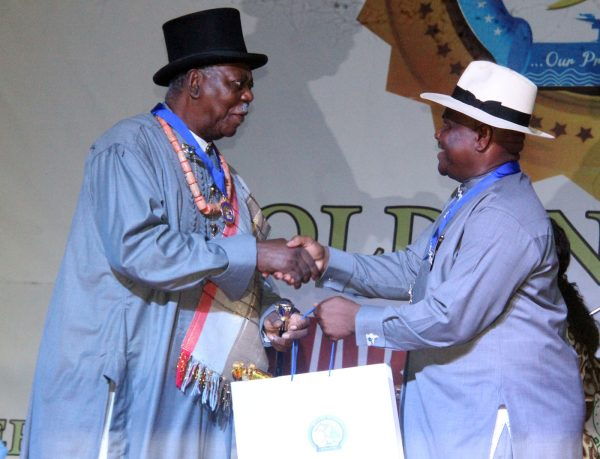 R-L Rivers State Governor, Nyesom Wike Presenting the Grand Service Star of Rivers State Award [GSSRS] to King Alfred Diete Spiff First Military Governor of Rivers State during the Rivers State Golden Jubilee Awards and houours Night Weekend in Port Harcourt. Photo: Nwankpa Chijioke