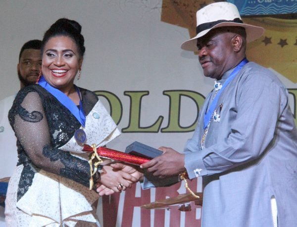 R-L Rivers State Governor, Nyesom Wike Presenting the Governor's Medal of Hounor Award [GMH] to Nolly Wood Actress, Hilda Dokubo during the Rivers State Golden Jubilee Awards and houours Night Weekend in Port Harcourt. Photo: Nwankpa Chijioke