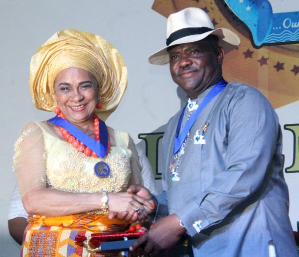 R-L Rivers State Governor, Nyesom Wike Presenting the Governor's Medal of Hounor Award [GMH] to Annkio Briggs during the Rivers State Golden Jubilee Awards and houours Night Weekend in Port Harcourt. Photo: Nwankpa Chijioke