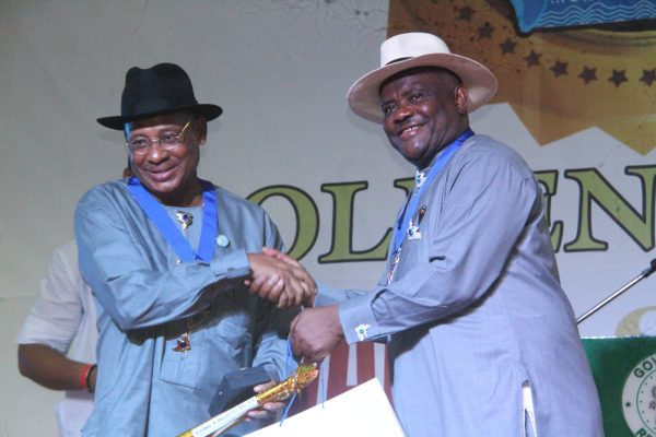 R-L Rivers State Governor, Nyesom Wike Presenting the Grand Service Star of Rivers State Award [GSSRS] to Sir Celestine Omehia Former Governor of Rivers State during the Rivers State Golden Jubilee Awards and houours Night Weekend in Port Harcourt. Photo: Nwankpa Chijioke