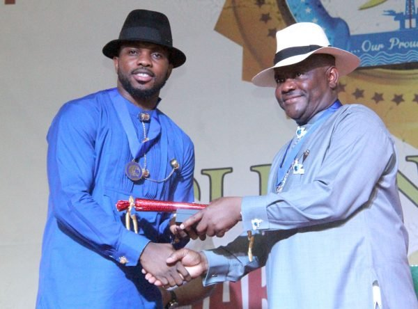 R-L Rivers State Governor, Nyesom Wike Presenting the Distinguish Service Star of Rivers State Award to Joseph Yobo Former Super Eagles Captain during the Rivers State Golden Jubilee Awards and houours Night Weekend in Port Harcourt. Photo: Nwankpa Chijioke