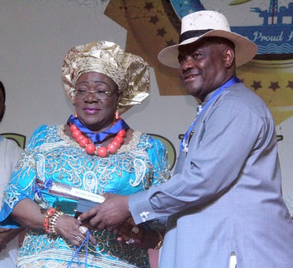 R-L Rivers State Governor, Nyesom Wike Presenting the Distinguish Service Star of Rivers State Award [DSSRS] to Dr Ndi Okereke Onyiuke, Former DG of Nigerian Stock Excchange during the Rivers State Golden Jubilee Awards and houours Night Weekend in Port Harcourt. Photo: Nwankpa Chijioke
