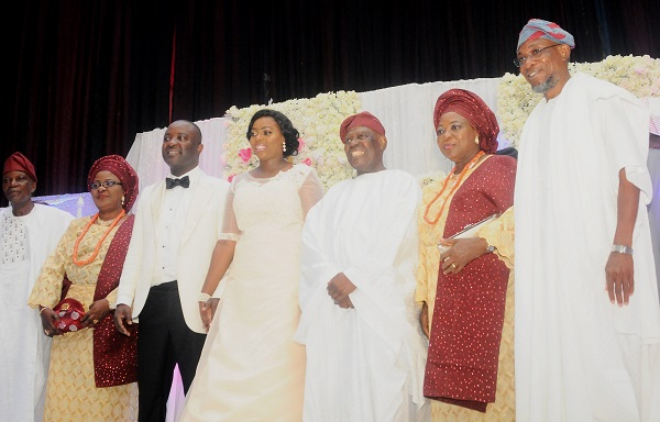 From right: Governor State of Osun, Ogbeni Rauf Aregbesola; Bride's Parents, Chief and Mrs. Adebisi Akande, Newly wedded couple, Wuraola Akande & Olawale Sholabi, and groom's parents, Pastor and Mrs. Olajide Sholabi, at the wedding ceremony between the families of Chief/ Mrs Akande and Pastor/Mrs Sholabi , at Thomas Hall, International Convention Centre, University of Ibadan, Oyo State, on Saturday 10-6-2017.