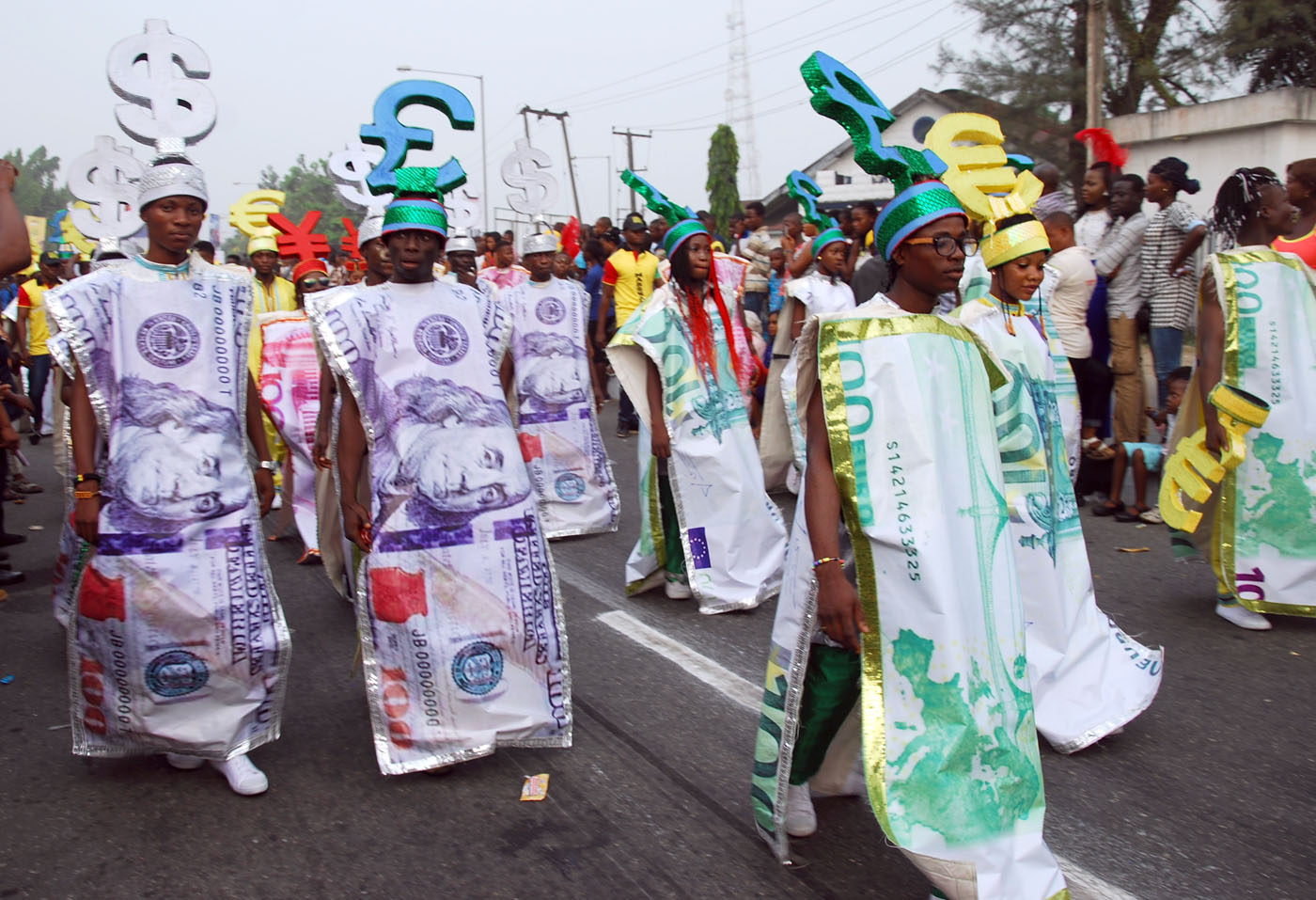 Members of Freedom Band wearing Foreign Currency Costume during the Main Event of the 2017 Carnival Calabar in Cross River State Yesterday. Photo: Nwankpa Chijioke