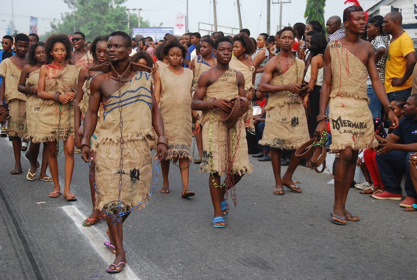 Members of Bayside Band wearing a Costume Depicting Slavery during the Main Event of the 2017 Carnival Calabar in Cross River State Yesterday. Photo: Nwankpa Chijioke