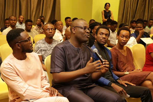 Chude Jideonwo, Co-Founder, RED and Yale Greenberg World Fellow answering making contributions during one of the panel discussions