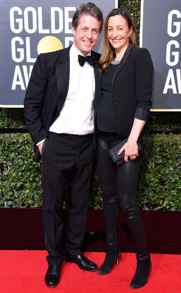 rs_634x1024-180107180950-634.Hugh-Grant-Anna-Eberstein-Golden-Globes.ms.010718.