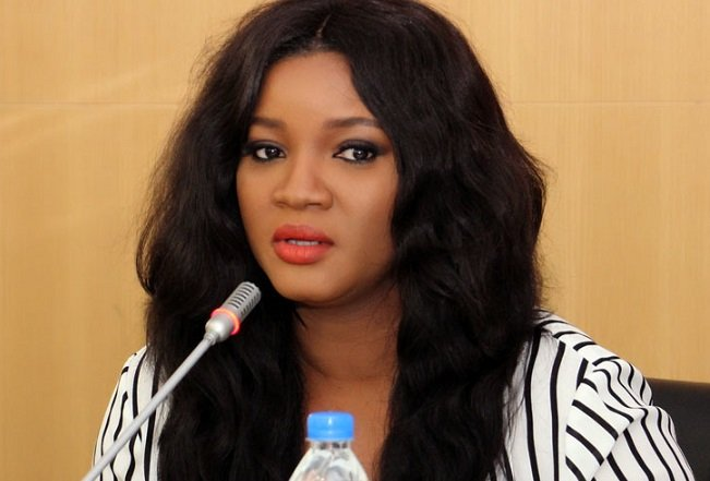 Nigerians react as Omotola and Buhari's aide exchange words