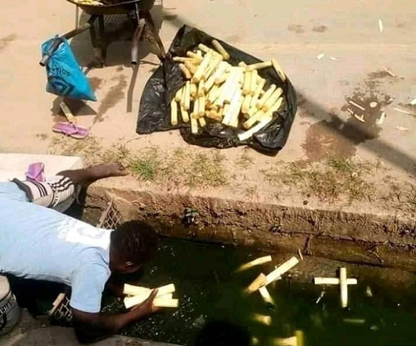 Outrage as trader retrieves sugarcane sticks from culvert for sale