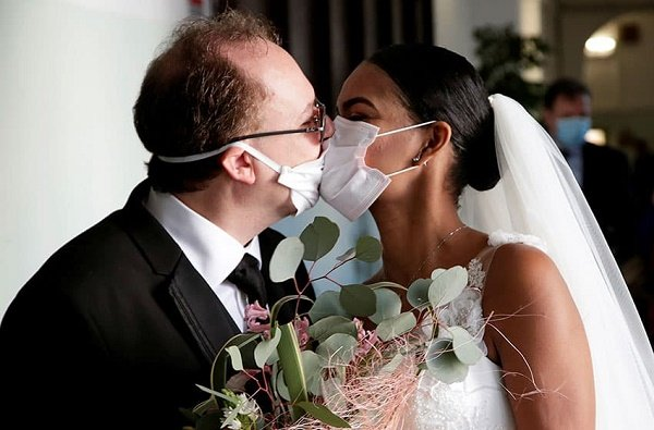 Couple wed in face masks at ceremony with no guests in Italy – world's worst hit country