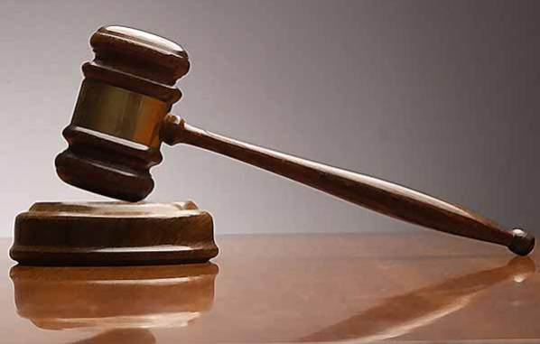 Police arraign man 'who boasted about beating wife on Facebook'