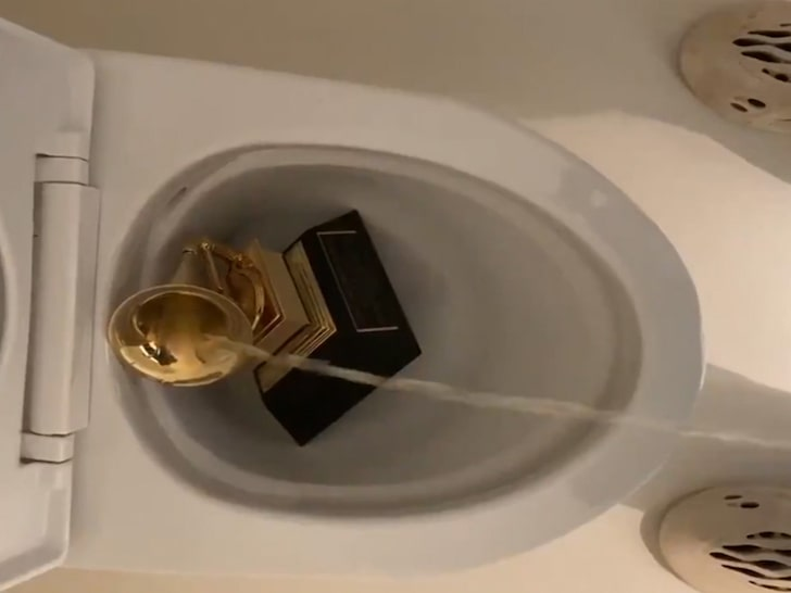 VIDEO: Kanye West pees on his Grammy award in Twitter rant against Universal