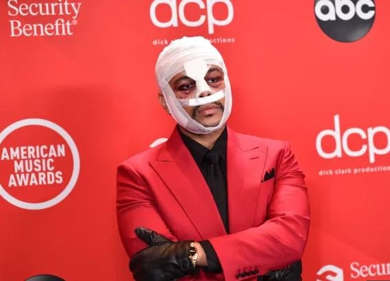 The Weeknd attends 2020 AMAs with bandaged face