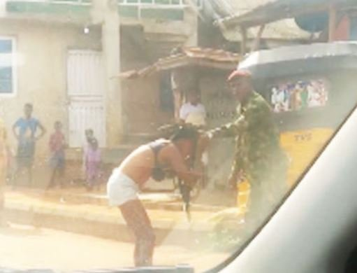 TRENDING VIDEO: Soldier strips lady over 'indecent dressing' in Ogun