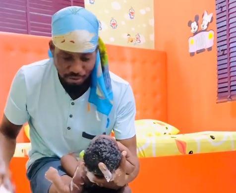 Junior Pope bathes third child in viral video