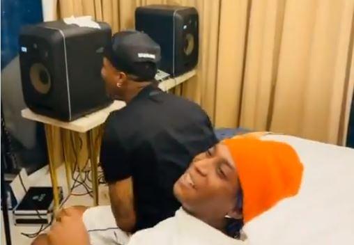 Fans react as Bella Shmurda, Wizkid link up in Ghana