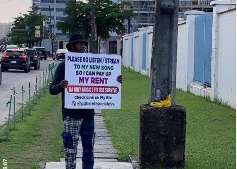 EXTRA: 'I need to pay my rent' -- artiste hits streets of Lagos to market his song