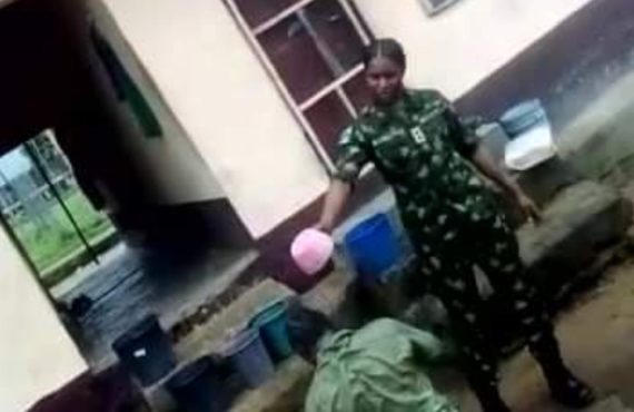 VIDEO: Soldier bathes corps member with dirty water 'over argument' in Calabar
